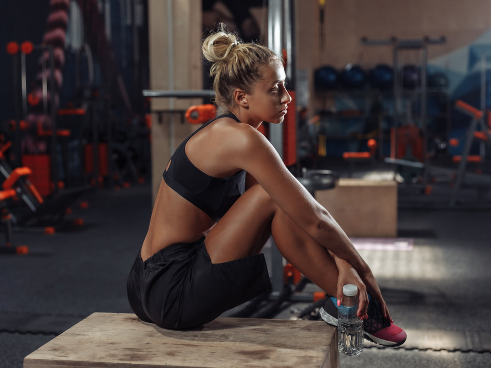 woman resting during workout