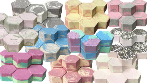 Bath Bombs and Fizzing Bath Cakes in Compostable Packaging & Made with Natural Fruit or Floral Powders