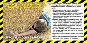 Farmhand lying prone on the ground with large roll of hay on top of him that has fallen when being stacked.