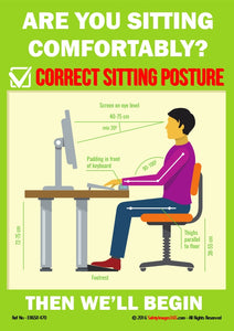 Male sat upright at desk using keyboard and looking at screen.