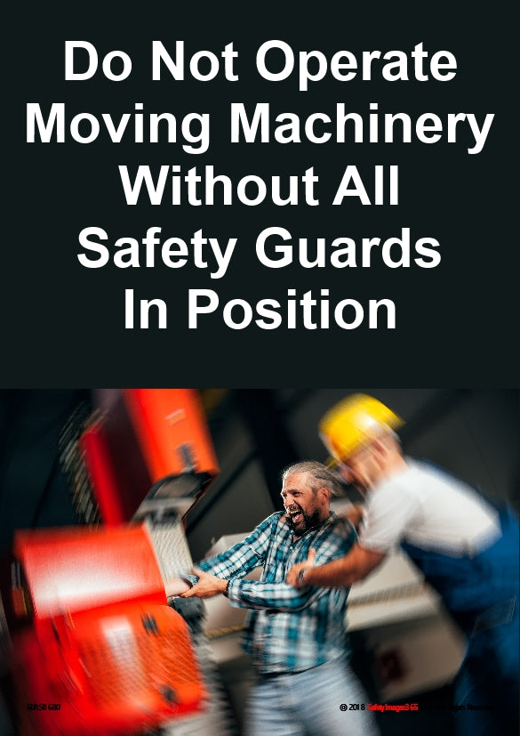 Man helping operator of a machine with no guards that has caught hold of his hand.