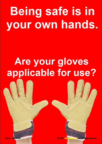 Image of a pair of hands wearing safety gloves.