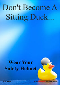 Picture of a rubber duck with a hard hat on.  Don't become a sitting duck, wear your safety helmet.