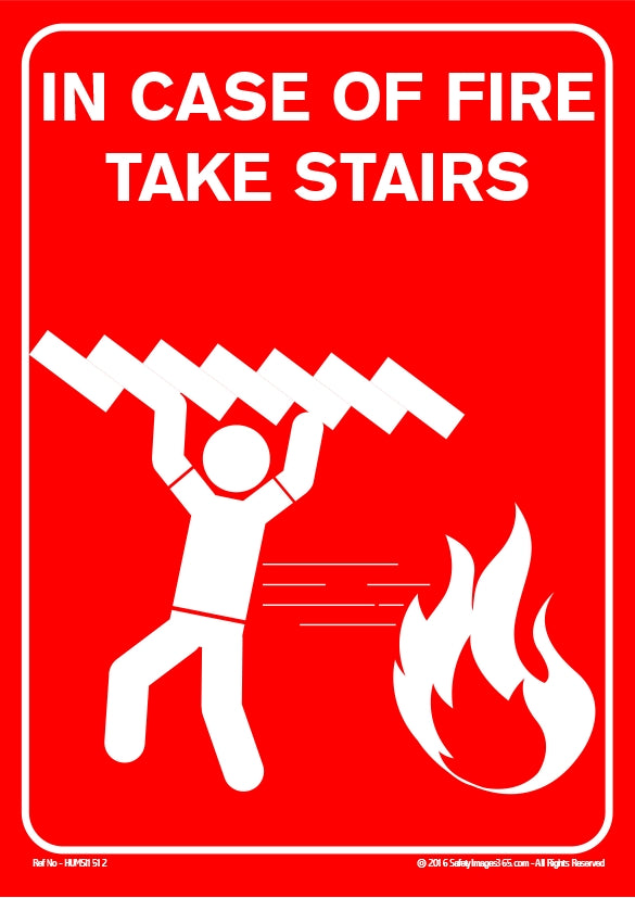 Image of a man carrying stairs away from a fire.