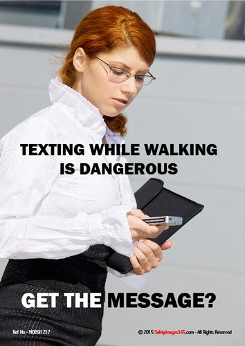 Picture of a woman using a mobile phone while walking.