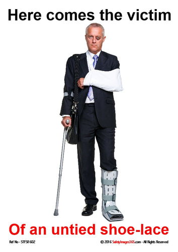 Business man with arm in a sling and leg in plaster, holding a crutch to walk with.