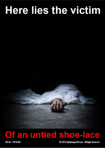 Body lying on floor covered with white sheet.
