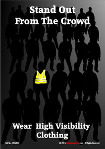 Picture of a group of people in the dark, one wearing high visibility clothing stands out from the crowd.