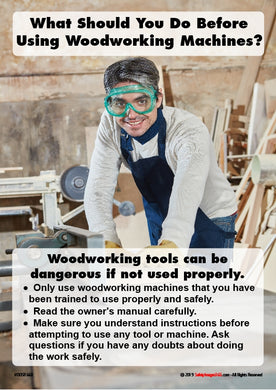 Woodworker with PPE on in joiners workplace.
