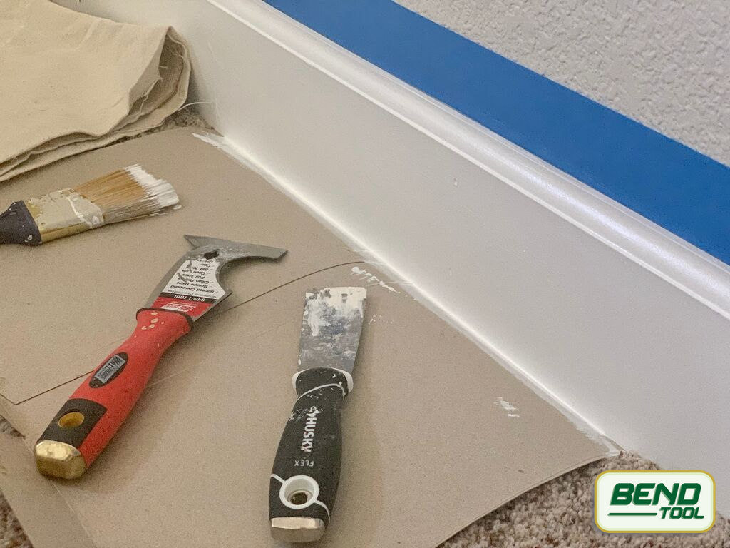 How to paint baseboards with carpet - putty knife, all in one tool to help remove painters tape and carpet protection