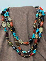 Triple Strand Necklace with Turquoise, Red, and Black Stones