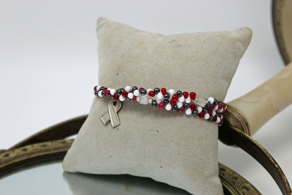 Black, Red, and White Beads with Silver Pendant Bracelet