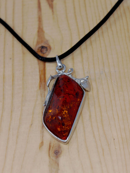 Orange/Red Stone with Silver Trim and Black Cord Necklace