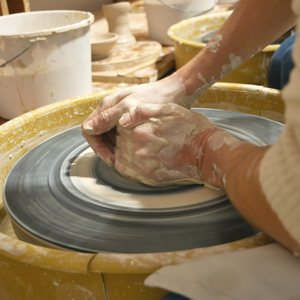 Creating pottery pieces for the first time at Alpharetta pottery studio A.C. Studios