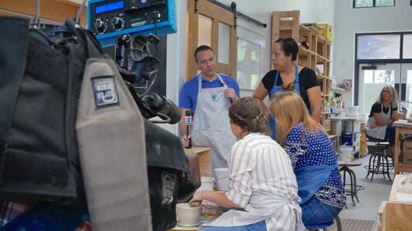 Hannah clay pottery instructor giving tips to one of the members live on Good Day Atlanta