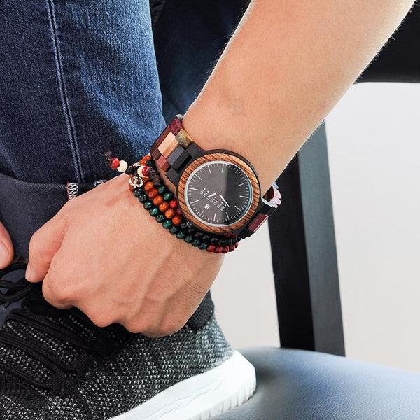Wood grain watch on wrist with beaded jewelry