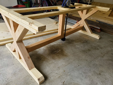 X Farmhouse table legs assembled with reinforced beam