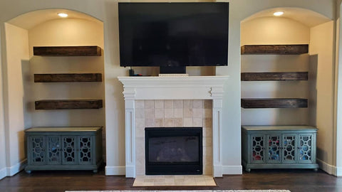 Floating shelves by fireplace floating shelves next to fireplace
