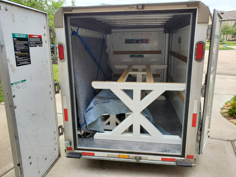 packed trailer delivering farmhouse table protected