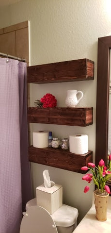 Custom wood floating shelves in bathroom