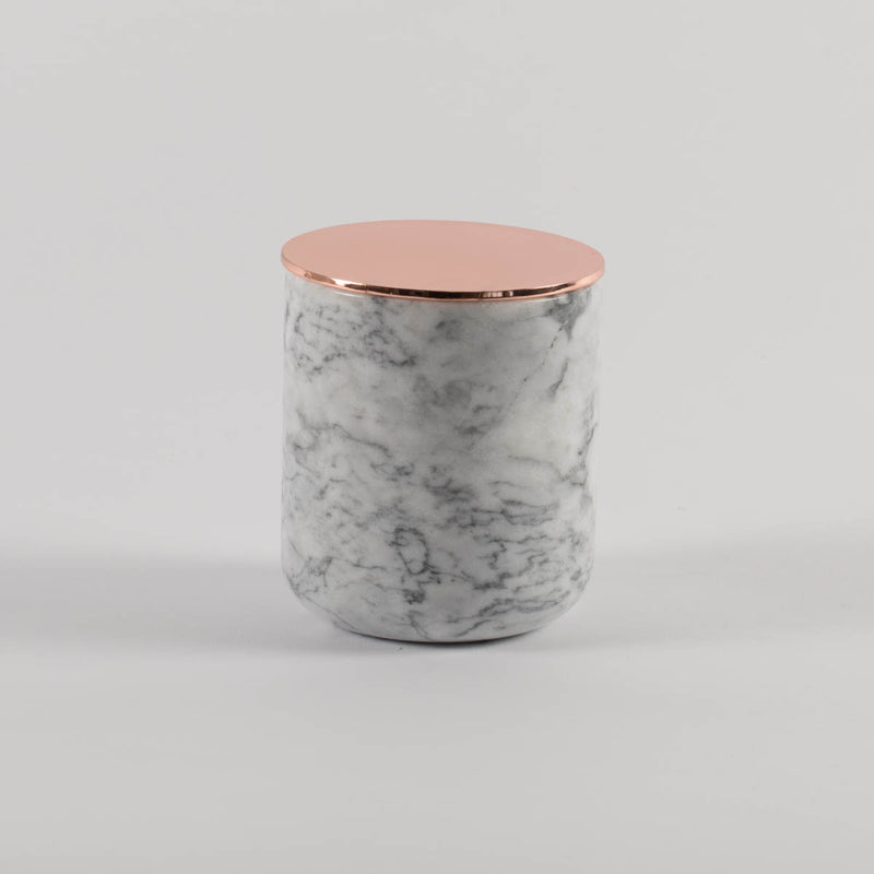 Candle in marble jars with rose gold lids