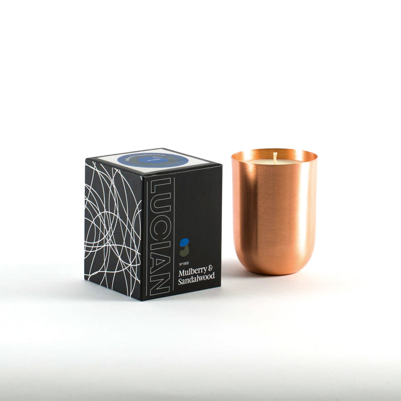 Mulberry and Sandalwood soy candle in copper jar and box on white background