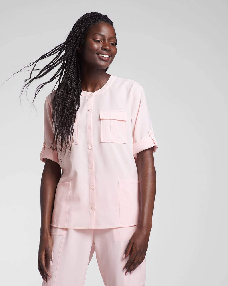 Pink scrub top and scrub pant by Happily Scrubbed