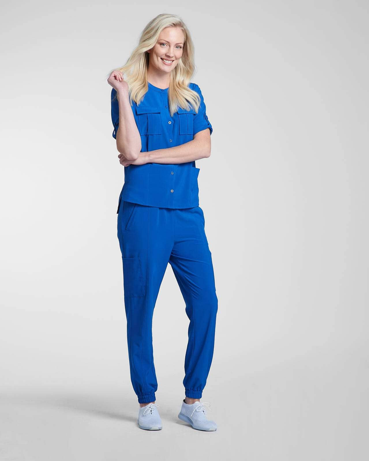 Blue scrub pocket top and jogger pant by Happily Scrubbed