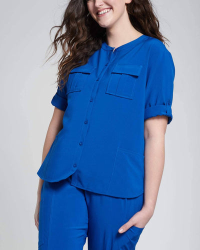 Button down fashion scrub top with pockets in blue