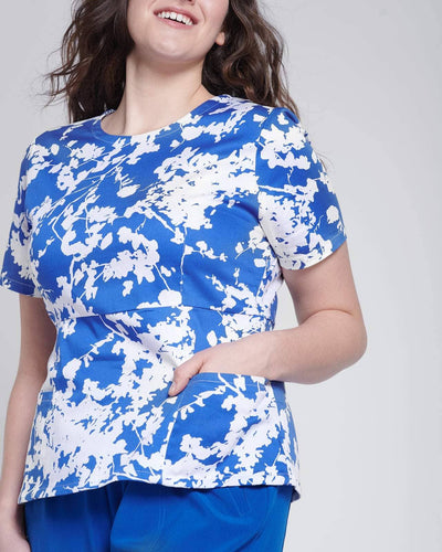 Fashion scrub top in blue floral print with pockets