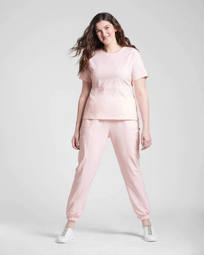 Pink scrub top and joggers scrub pant by Happily Scrubbed