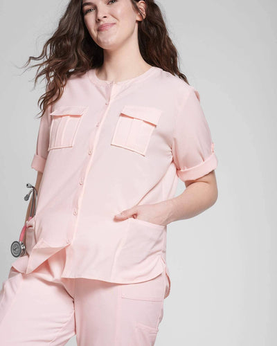 Pink scrub pocket top and jogger pant by Happily Scrubbed