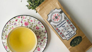Organic Miraculous Tea pack and tea cup with herbal tea