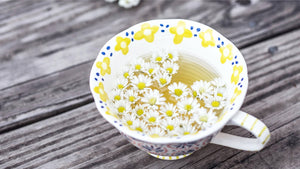 Chamomile tea - flowers in a tea cup