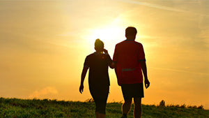 Man and woman walking in the sunset