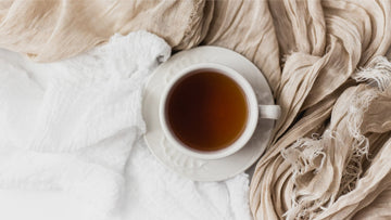 A cup of herbal tea on a scarf