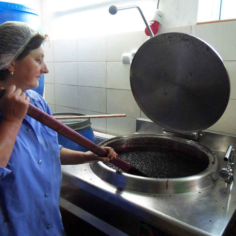 Boiling and stirring the fruit jam