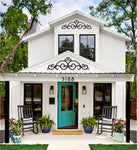 Cute Bungalow with turquoise door and wrought iron accents in gables.
