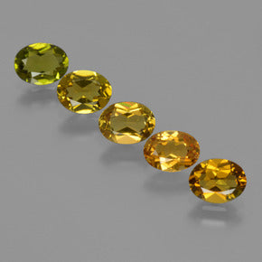 2.56 ct (total) Oval Facet Yellowish Green Tourmaline 5.9 x 4.5 mm