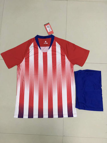 Full Football Kit - Red and white stripes top with blue shorts.