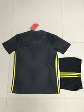 Load image into Gallery viewer, Full Football Kit - Black top and shorts with Yellow detail.