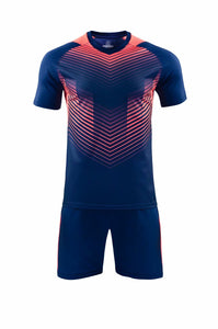 Full Football Kit - Royal Blue with Red Graphic Print and Blue Shorts.
