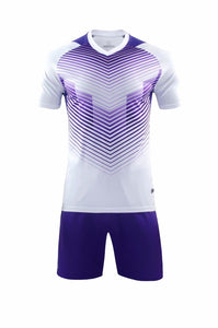 Full Football Kit - White with Purple Graphic Print and Purple Shorts.