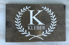 12x16 inch wood sign family name and initial with laurels