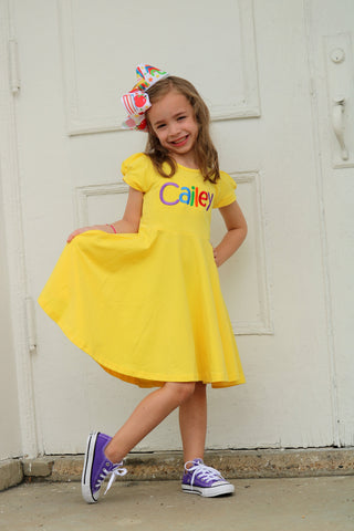 Back To School Dress for Girls, Twirly Dress in Buttercup with rainbow name - Darling Little Bow Shop