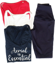 Load image into Gallery viewer, Red, white and blue Aerial is Essentials racerback tank shown with navy leggings