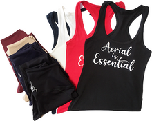 Load image into Gallery viewer, Aerial is Essentials racerback tanks shown with leggings