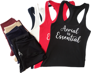 Aerial is Essentials racerback tanks shown with leggings
