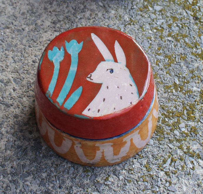Small Pink Rabbit on Red & Orange Lidded Box