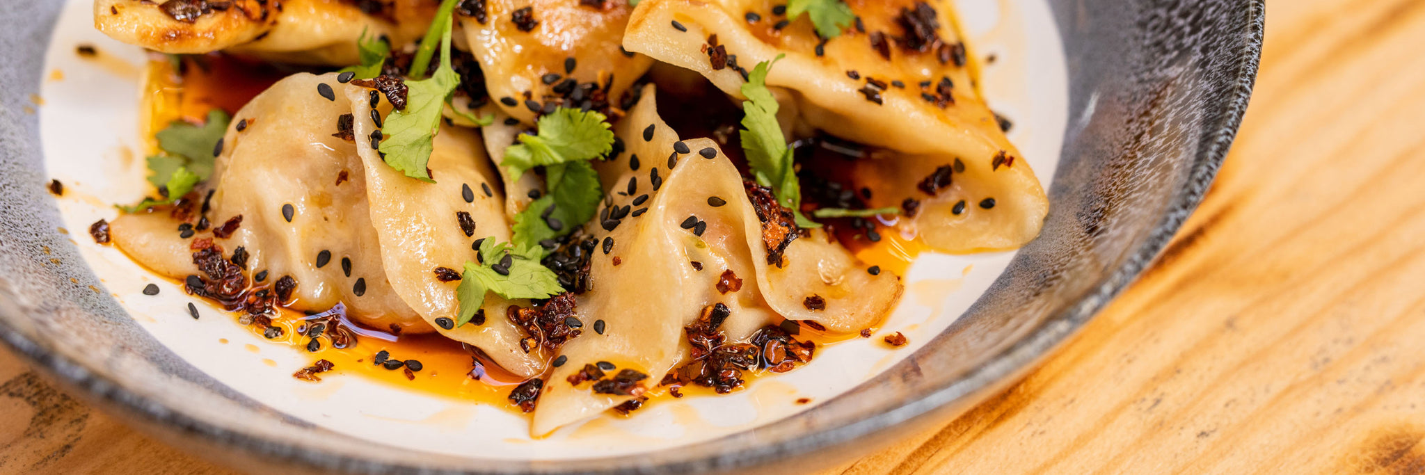Pan fried pork and kimchi dumplings